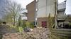Stenen muur komt naar beneden in Zwanenburg en verwoest tuinset