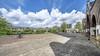 'Geen bomen, maar bussen voor de deur'; Teleurstelling over uitgekleed groenpark rond Koepelkathedraal